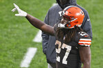 Cleveland Browns running back Kareem Hunt (27) celebrates after the Browns defeated the Philadelphia Eagles in an NFL football game, Sunday, Nov. 22, 2020, in Cleveland. (AP Photo/Ron Schwane)
