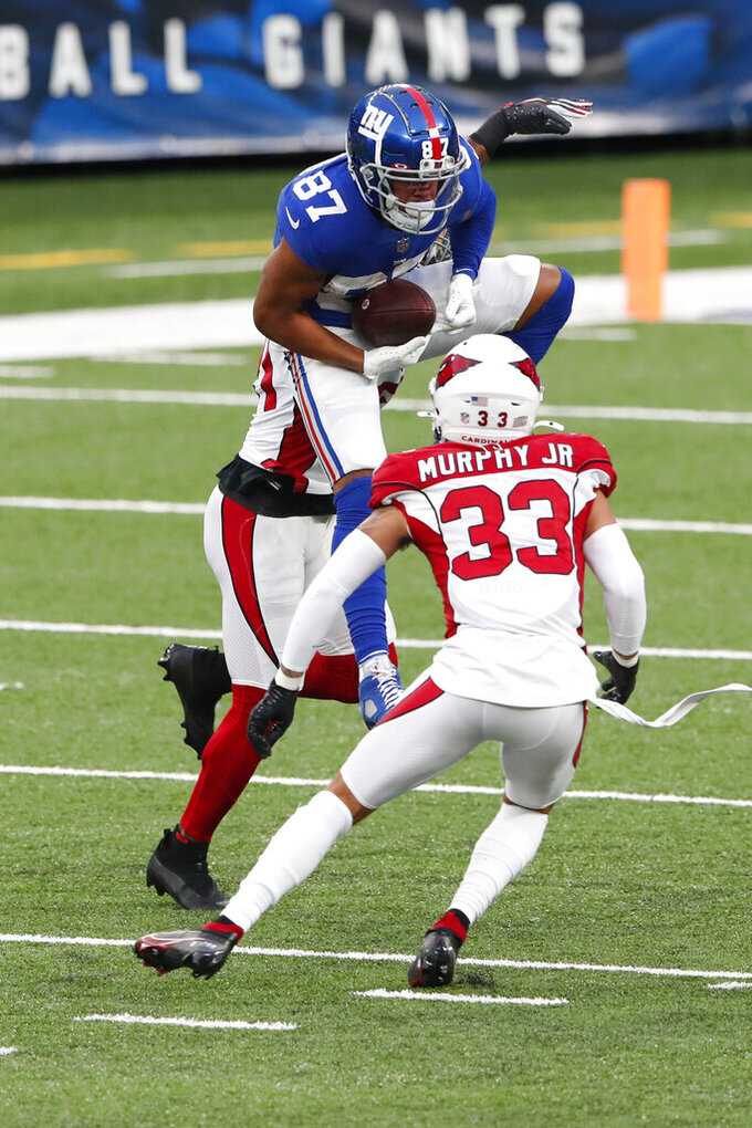 New York Giants' Sterling Shepard, top, makes a catch during the second half of an NFL football game against the Arizona Cardinals, Sunday, Dec. 13, 2020, in East Rutherford, N.J. (AP Photo/Noah K. Murray)