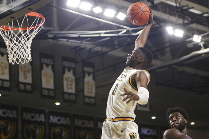 VCU guard De'Riante Jenkins (0) dunks the ball  against St. Francis during the second half of an NCAA college basketball game in Richmond, Va., Tuesday, Nov. 5, 2019. (AP Photo/Zack Wajsgras)