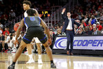 Cincinnati coach John Brannen calls to players during the first half of the team's NCAA college basketball game against Tulsa on Wednesday, Jan. 8, 2020, in Cincinnati. (Kareem Elagazzar/The Cincinnati Enquirer via AP)