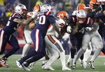 New England Patriots defensive tackle Adam Butler, second from left, sacks Cleveland Browns quarterback Baker Mayfield in the first half of an NFL football game, Sunday, Oct. 27, 2019, in Foxborough, Mass. (AP Photo/Elise Amendola)
