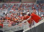 Oklahoma State students Carson Allen, of Sheridan, Arkansas (left) and Zane Wyatt, of Owasso, cheer for the team during an NCAA college football game against Tulsa on Saturday, Sept. 19, 2020, in Stillwater, Okla. (John Clanton/Tulsa World via AP)