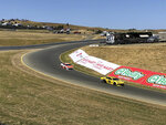 "Daniel Hemric (8) and William Byron (24) drive into ""The Carousel"" at Sonoma Raceway during a NASCAR Cup Series practice Friday, June 21, 2019 in Sonoma, Calif. The track has put the tricky carousel turn back into its layout for the first time since 1997. (AP Photo/Greg Beacham)"