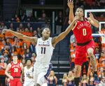Illinois guard Ayo Dosunmu (11) and Nebraska guard James Palmer Jr. (0) go after the ball during the second half of an NCAA college basketball game in Champaign, Ill., Saturday, Feb. 2, 2019. (AP Photo/Robin Scholz)
