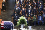 Mourners attend the funeral service for the late Rep. John Lewis, D-Ga., at Ebenezer Baptist Church in Atlanta, Thursday, July 30, 2020.  (Alyssa Pointer/Atlanta Journal-Constitution via AP, Pool)