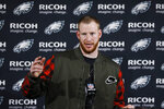 FILE - Philadelphia Eagles quarterback Carson Wentz speaks with members of the media after an NFL football game against the Dallas Cowboys in Philadelphia, in this Sunday, Dec. 22, 2019, file photo. The Philadelphia Eagles have agreed to trade Carson Wentz to the Indianapolis Colts, according to a person familiar with the deal. The person spoke to The Associated Press on condition of anonymity because the deal hasn't been announced. (AP Photo/Michael Perez, File)
