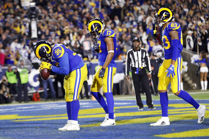 FILE - In this Jan. 12, 2019, file photo, Los Angeles Rams running back C.J. Anderson celebrates after scoring against the Dallas Cowboys during the first half of an NFL divisional football playoff game in Los Angeles. Elite quarterbacks aren't the only thing the four teams left in the playoffs have in common. The Rams, Patriots and Saints were among the top six in rushing.  Anderson (123) and Todd Gurley (115) had big games as Los Angeles ran for 273 yards in a 30-22 win against Dallas in the divisional round. (AP Photo/Marcio Jose Sanchez, File)