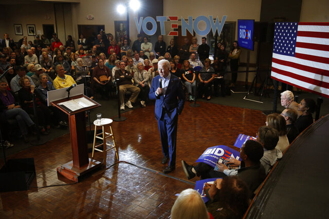 Democratic presidential candidate and former Vice President Joe Biden, center, speaks at a campaign event Friday, Feb. 14, 2020, in Henderson, Nev. (AP Photo/John Locher)