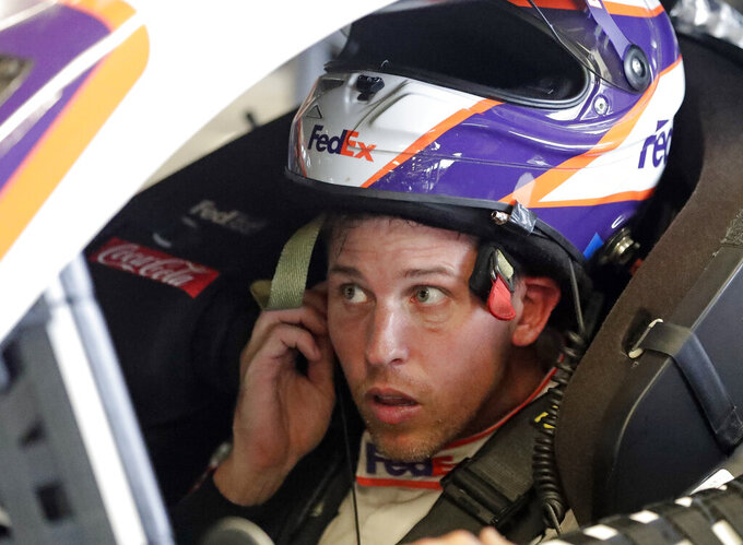 Denny Hamlin gets ready to go out onto the track during a NASCAR auto race practice at Daytona International Speedway, Thursday, July 4, 2019, in Daytona Beach, Fla. (AP Photo/John Raoux)