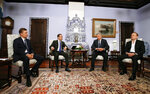 From left, Russian gas monopoly Gazprom Head Alexei Miller, Russian Prime Minister Dmitry Medvedev, Ukrainian presidential candidate Yuri Boyko and Ukrainian politician Viktor Medvedchuk talk during their meeting in Moscow, Russia, Friday, March 22, 2019. A Ukrainian presidential candidate has traveled to Moscow to meet with the Russian prime minister to discuss gas supplies. (Yekaterina Shtukina, Sputnik, Government Pool Photo via AP)