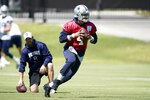 Dallas Cowboys quarterback Dak Prescott (4) participates in practice at the team's NFL football training facility in Frisco, Texas, Thursday, Sept. 23, 2021. (AP Photo/Tony Gutierrez)