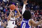 Gonzaga guard Ryan Woolridge (4) shoots over Texas-Arlington guard Brian Warren (0) during the second half of an NCAA college basketball game in Spokane, Wash., Tuesday, Nov. 19, 2019. Gonzaga won 72-66. (AP Photo/Young Kwak)