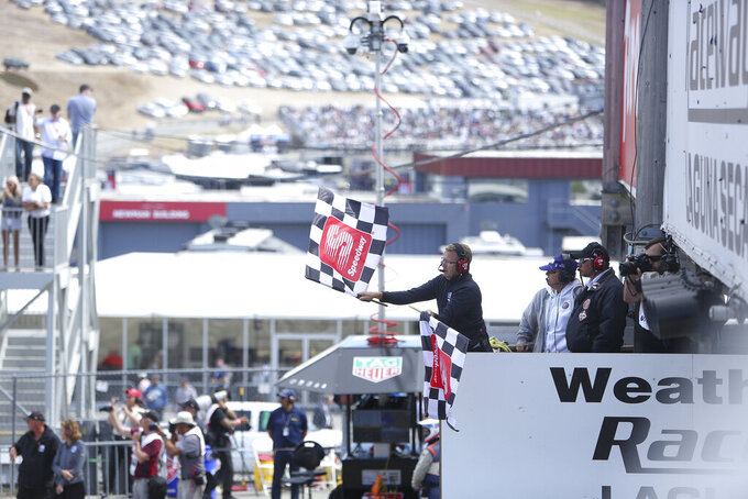 The checkered flag is waved at the end of the Firestone Grand Prix of Monterey Sunday at Laguna Seca.(Elias Funez/The Union via AP)