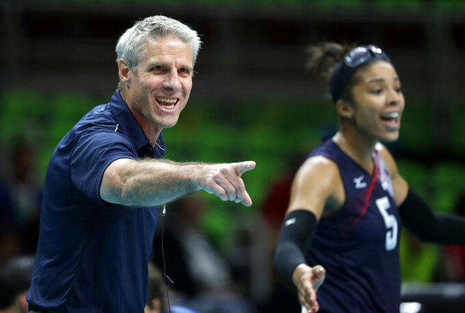 FILE - In this Aug. 20, 2016, file photo, United States head coach Karch Kiraly, left, and Rachael Adams react on the sideline during a women's bronze medal volleyball match against the Netherlands at the Summer Olympics in Rio de Janeiro, Brazil. When the pandemic hit last March leading to a one year postponement of the Olympics and the inability of teams to practice and play together, the U.S. women's volleyball team devised a plan. Unable to work together on serves, sets or spikes, they decided to use that extra time to work on culture, relationships and teamwork. (AP Photo/Jeff Roberson, File)