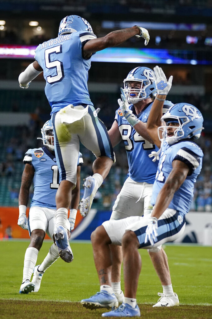 North Carolina wide receiver Dazz Newsome (5) celebrates with his teammates after scoring a touchdown, during the first half of the Orange Bowl NCAA college football game against Texas A&M, Saturday, Jan. 2, 2021, in Miami Gardens, Fla. (AP Photo/Lynne Sladky)