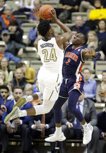 Vanderbilt forward Aaron Nesmith (24) shoots against Auburn guard Jared Harper (1) in the first half of an NCAA college basketball game Saturday, Feb. 16, 2019, in Nashville, Tenn. (AP Photo/Mark Humphrey)
