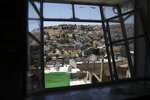 A general view of a Palestinian neighborhood of Silwan in east Jerusalem, seen on Wednesday, July 1, 2020. Israeli leaders paint Jerusalem as a model of coexistence, the