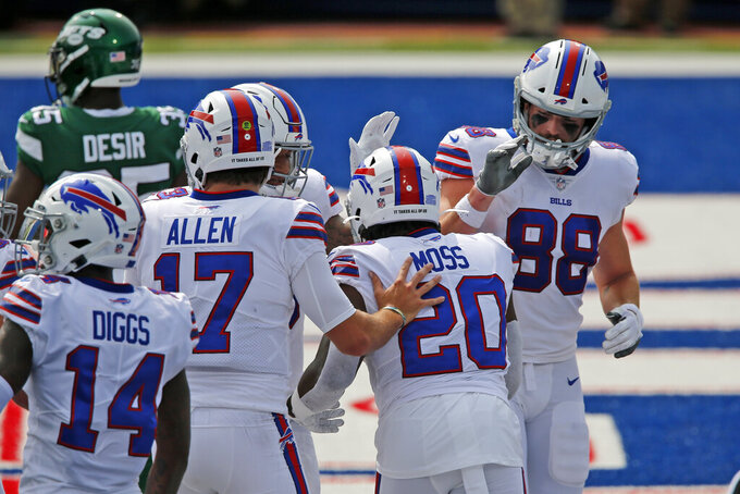 Buffalo Bills quarterback Josh Allen (17) celebrates with running back Zack Moss (20) after a touchdown during the first half of an NFL football game against the New York Jets in Orchard Park, N.Y., Sunday, Sept. 13, 2020. (AP Photo/John Munson)