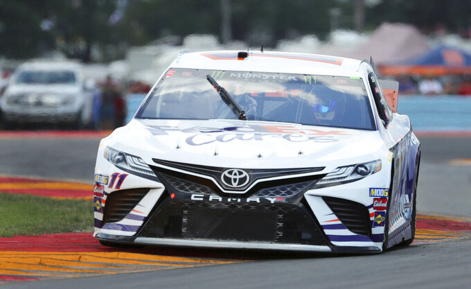 "Denny Hamlin (11) heads through the area known as ""The Bus Stop"" during a practice run for a NASCAR Cup Series auto race at Watkins Glen International, Saturday, Aug. 3, 2019, in Watkins Glen, N.Y. (AP Photo/John Munson)"