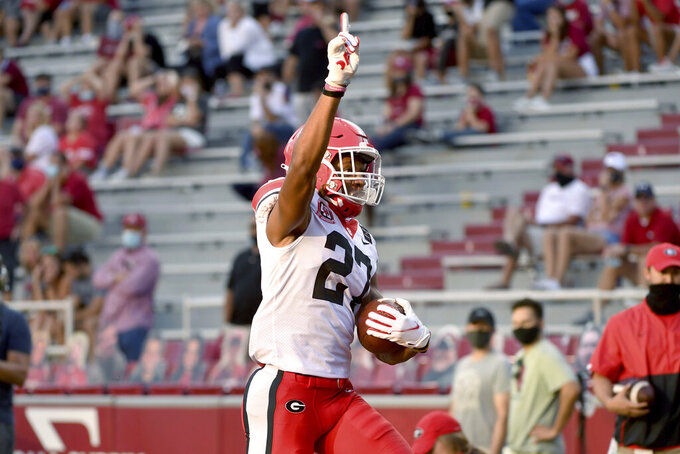 Georgia defensive back Eric Stokes (27) celebrates as he returns an interception for a touchdown against Arkansas during the second half of an NCAA college football game in Fayetteville, Ark., Saturday, Sept. 26, 2020. (AP Photo/Michael Woods)