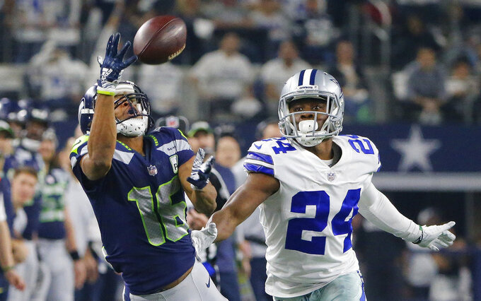 Seattle Seahawks wide receiver Tyler Lockett (16) vies for a catch against Dallas Cowboys cornerback Chidobe Awuzie (24) during the first half of the NFC wild-card NFL football game in Arlington, Texas, Saturday, Jan. 5, 2019. (AP Photo/Michael Ainsworth)