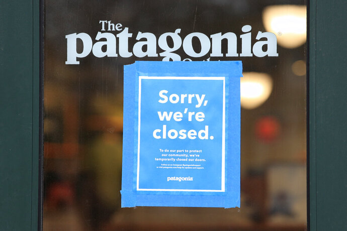 "FILE - This April 9, 2020 file photo shows a closed Patagonia clothing store in Freeport, Maine. The outdoor gear company Patagonia is the latest brand to announce an advertising boycott of Facebook and its Instagram app, saying the social media giant has ""failed to take steps to stop the spread of hateful lies and dangerous propaganda on its platform."
