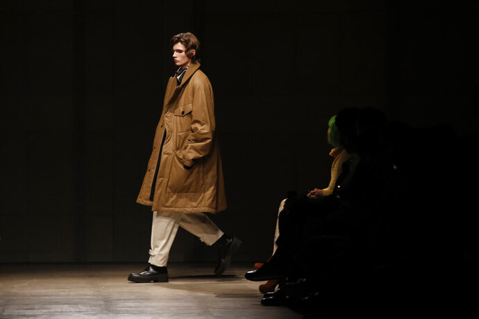 A model presents a creation for the Hermes Mens Fall/Winter 2020-2021 fashion collection presented in Paris, Saturday Jan. 18, 2020. (AP Photo/Francois Mori)