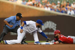 Chicago Cubs second baseman David Bote, center, tags out Cincinnati Reds' Jesse Winker, right, at second base during the first inning of a baseball game, Monday, July 26, 2021, in Chicago. (AP Photo/Paul Beaty)