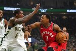 Toronto Raptors' Kyle Lowry tries to drive past Milwaukee Bucks' Eric Bledsoe during the first half of an NBA basketball game Saturday, Nov. 2, 2019, in Milwaukee. (AP Photo/Morry Gash)