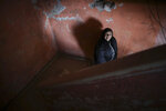 """Susana Ordoñez poses for a photo in the stairwell of the building she resides in Buenos Aires, Argentina, Tuesday, Oct. 29, 2019.The day after Sunday's elections, Ordoñez cried as she recalled the suffering caused by one of the worst economic crises in recent years. The tears of sadness intermingled with those of hope hope, """"I don't know what the future will hold for us, I hope it improves"""