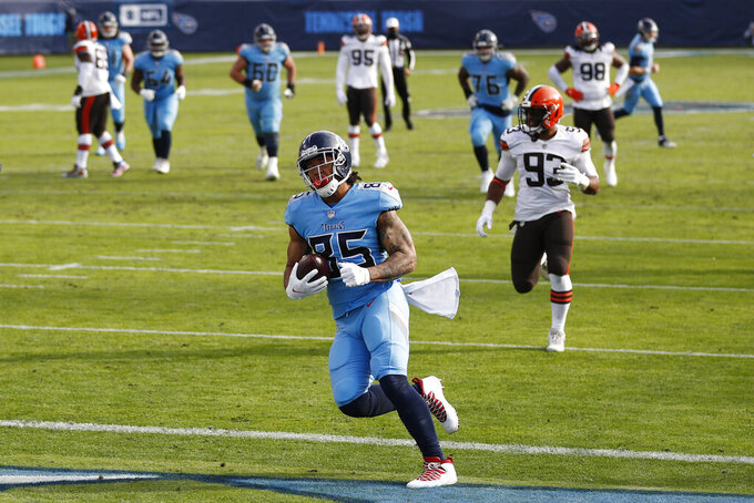 Tennessee Titans tight end MyCole Pruitt (85) scores a touchdown against the Cleveland Browns in the second half of an NFL football game Sunday, Dec. 6, 2020, in Nashville, Tenn. (AP Photo/Wade Payne)