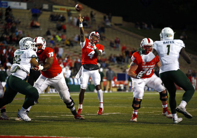 New Mexico quarterback Sheriron Jones (4) throws a touchdown pass during the first half of the team's NCAA college football game against Colorado State on Friday, Oct. 11, 2019 in Albuquerque, N.M. (AP Photo/Andres Leighton)