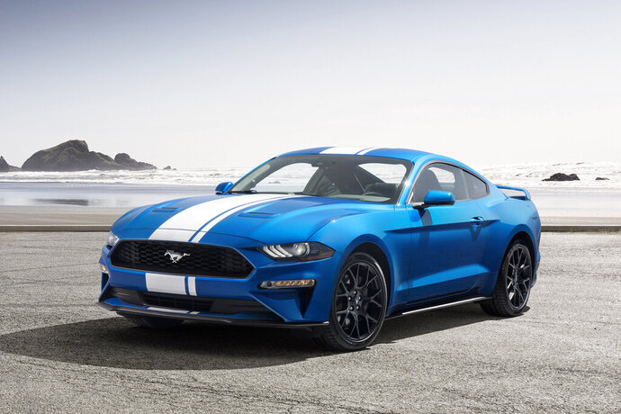 This undated photo provided by Ford shows a 2019 Ford Mustang. This entry-level Mustang also comes standard with a surprising amount of racy hardware, including a limited-slip rear differential for improved traction and an electronic line-lock to facilitate burnouts. (Ford via AP)