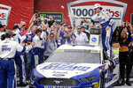 Ryan Blaney celebrates in Victory Lane after winning a NASCAR Cup Series auto race at Talladega Superspeedway, Monday, Oct 14, 2019, in Talladega, Ala. (AP Photo/Butch Dill)