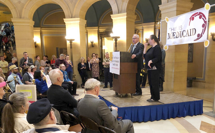 Minnesota Gov. Tim Walz speaks in support of preserving the state's health care provider tax during a rally in the state Capitol rotunda on Thursday, March 21, 2019 in St. Paul. Walz is turning up the heat on lawmakers to try to prevent the state's 2 percent tax on health care providers from expiring at the end of the year. (AP Photo/Steve Karnowski)