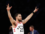 Toronto Raptors guard Fred VanVleet (23) gestures toward the Raptors bench after hitting a 3-point shot during the second half of an NBA basketball game against the Brooklyn Nets, Tuesday, March 13, 2018, in New York. The Raptors defeated the Nets 116-102. (AP Photo/Kathy Willens)