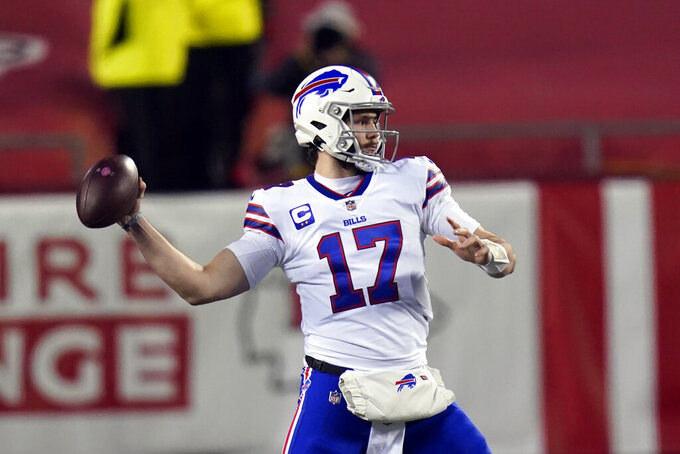 Buffalo Bills quarterback Josh Allen throws a pass during the first half of the AFC championship NFL football game against the Kansas City Chiefs, Sunday, Jan. 24, 2021, in Kansas City, Mo. (AP Photo/Orlin Wagner)