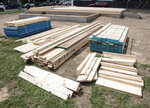 Cuts of lumber are sorted out at a construction site. Prices for lumber got as high as $1,700 per thousand board feet in May due to variety of reasons, including pandemic supply issues and permanent closure of mills. (Marc Clery/Delaware State News via AP)