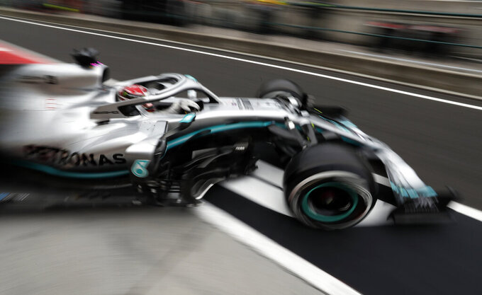 Mercedes driver Lewis Hamilton of Britain exits his pit area during the second practice session of the Hungarian Formula One Grand Prix at the Hungaroring racetrack in Mogyorod, northeast of Budapest, Hungary, Friday, Aug. 2, 2019. The Hungarian Formula One Grand Prix takes place on Sunday. (AP Photo/Laszlo Balogh)