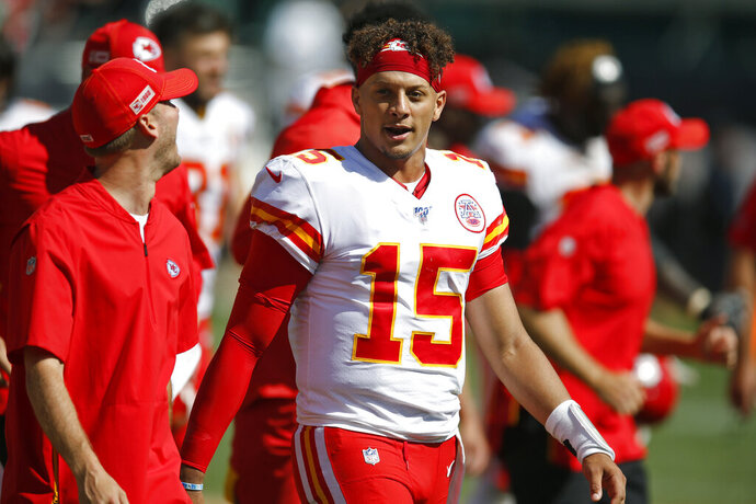 Kansas City Chiefs quarterback Patrick Mahomes stands on the sidelines during the second half of an NFL football game against the Oakland Raiders Sunday, Sept. 15, 2019, in Oakland, Calif. (AP Photo/D. Ross Cameron)