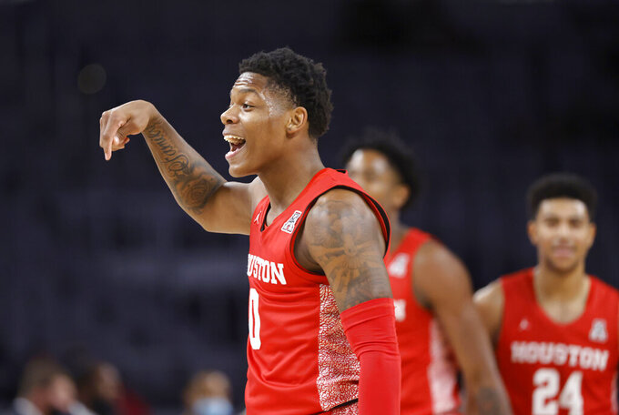 Houston guard Marcus Sasser (0) reacts after making a three-point shot against Texas Tech during the first half of an NCAA college basketball game, Sunday, Nov. 29, 2020, in Fort Worth, Texas. (AP Photo/Ron Jenkins)