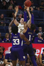 California forward Grant Anticevich (15) is defended by Washington forwards Isaiah Stewart (33) and Nate Roberts (1) during the first half of an NCAA college basketball game in Berkeley, Calif., Saturday, Jan. 11, 2020. (AP Photo/Jed Jacobsohn)