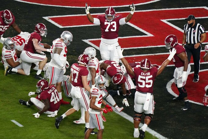 Alabama running back Najee Harris (22) scores a touchdown against Ohio State during the first half of an NCAA College Football Playoff national championship game, Monday, Jan. 11, 2021, in Miami Gardens, Fla. (AP Photo/Wilfredo Lee)