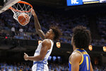 North Carolina forward Armando Bacot (5) dunks while Pittsburgh guard Justin Champagnie (11) looks on during the first half of an NCAA college basketball game in Chapel Hill, N.C., Wednesday, Jan. 8, 2020. (AP Photo/Gerry Broome)