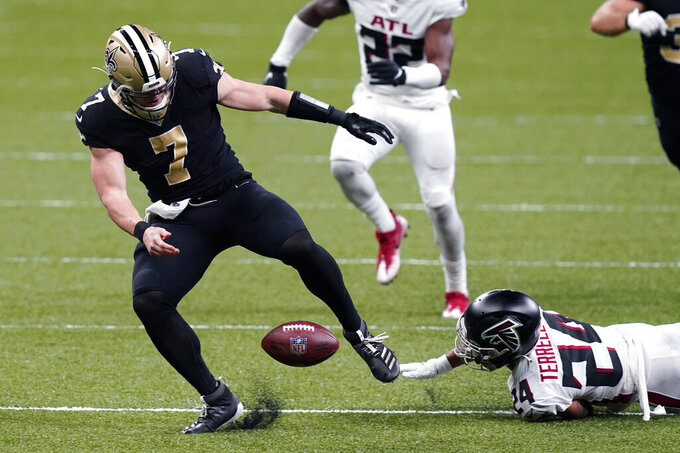 New Orleans Saints quarterback Taysom Hill (7) fumbles after being stripped of the ball by Atlanta Falcons cornerback A.J. Terrell (24), who recovered the fumble, in the second half of an NFL football game in New Orleans, Sunday, Nov. 22, 2020. (AP Photo/Butch Dill)