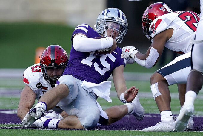 Kansas State quarterback Will Howard (15) is tackled by Texas Tech defensive lineman Eli Howard (53) during the second half of an NCAA college football game Saturday, Oct. 3, 2020, in Manhattan, Kan. (AP Photo/Charlie Riedel)