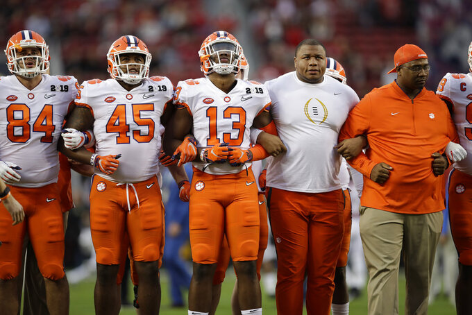 Clemson's Dexter Lawrence stands with teammates before the NCAA college football playoff championship game against Alabama Monday, Jan. 7, 2019, in Santa Clara, Calif. Lawrence will not play after being tested positive for the same performance-enhancing drugs. (AP Photo/Ben Margot)