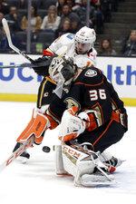 Anaheim Ducks goaltender John Gibson (36) stop a shot next to Calgary Flames' Tobias Rieder during the first period of an NHL hockey game Sunday, Oct. 20, 2019, in Anaheim, Calif. (AP Photo/Marcio Jose Sanchez)