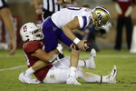Washington quarterback Jacob Eason is sacked by Stanford's Scooter Harrington, left, in the second half of an NCAA college football game Saturday, Oct. 5, 2019, in Stanford, Calif. (AP Photo/Ben Margot)