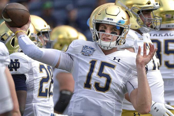 FILE - In this Dec. 28, 2019, file photo, Notre Dame quarterback Phil Jurkovec warms up before the Camping World Bowl NCAA college football game against Iowa in Orlando, Fla. Jurkovec transferred to Boston College, where he is expected to be the starting quarterback for the Eagles in 2020. (AP Photo/Phelan M. Ebenhack, File)